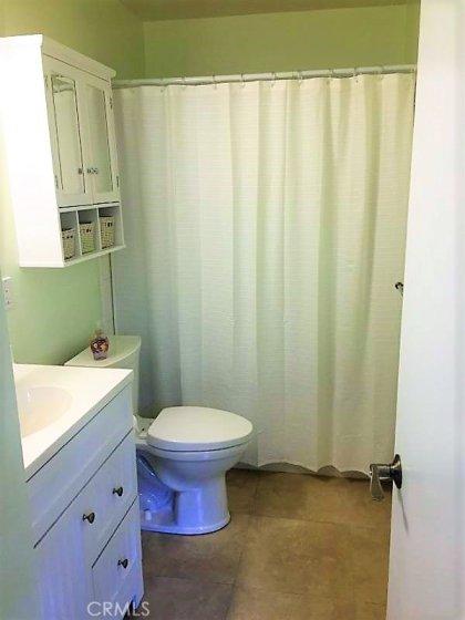 Remodeled Bathroom.  Shower over tub.
