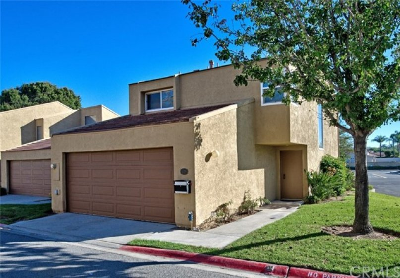 This wonderful end unit is surrounded by a greenbelt and has an attached 2 car garage with direct access to the home.
