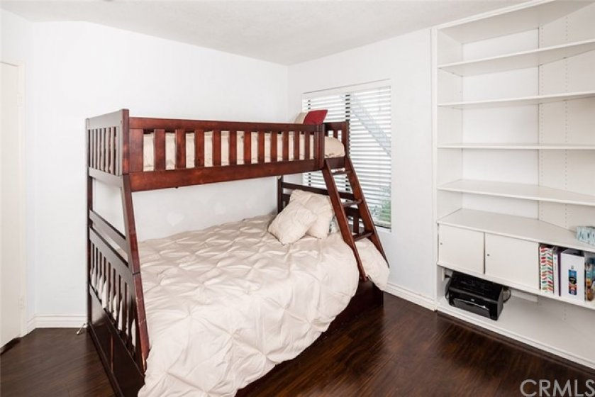 Secondary Bedroom with custom installed shelving