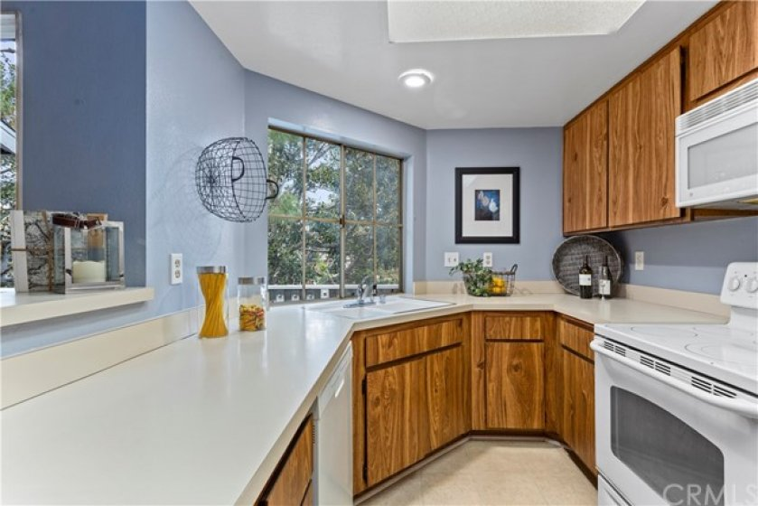 Beautiful Kitchen with a Great View of Another Waterfall.  In the left of the Picture is a Glimpse of the Breakfast Bar.