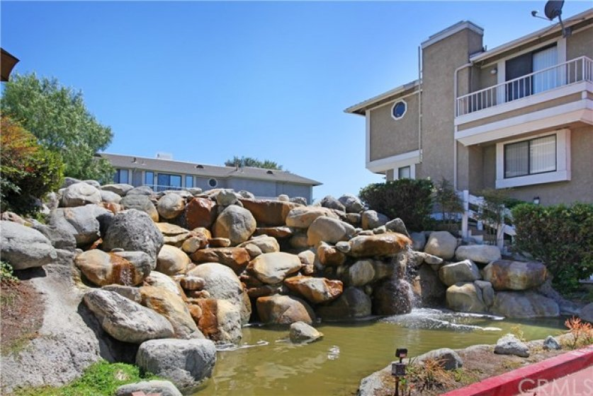 Beautiful waterfall welcomes you to your community!  Also inside the complex is a lake and bridge