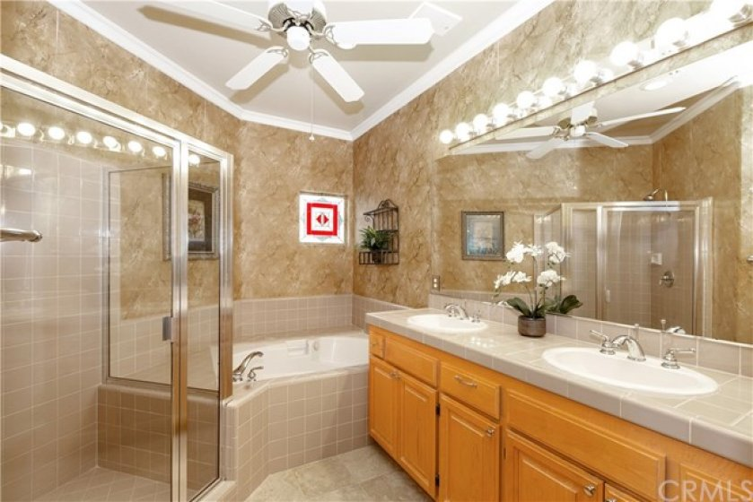 Luxury awaits you here in the master bathroom with dual vanity sinks, separate shower and tub and large walk-in closet.