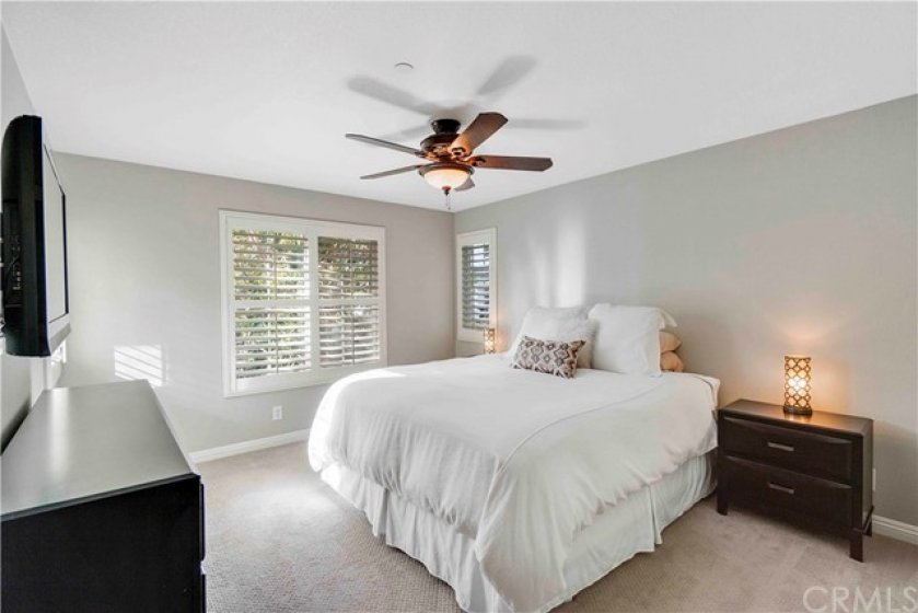 The front master suite provides for maximum comfort with a walk-in closet, ceiling fan and plantation shutters.