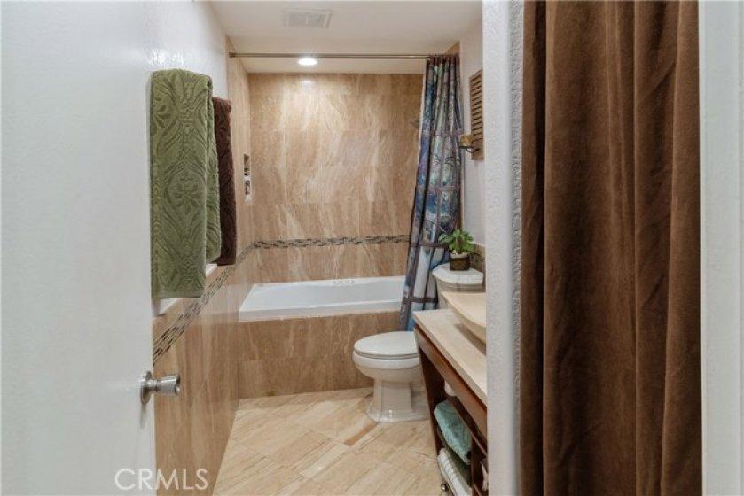 Remodeled shower/jacuzzi tub bathroom