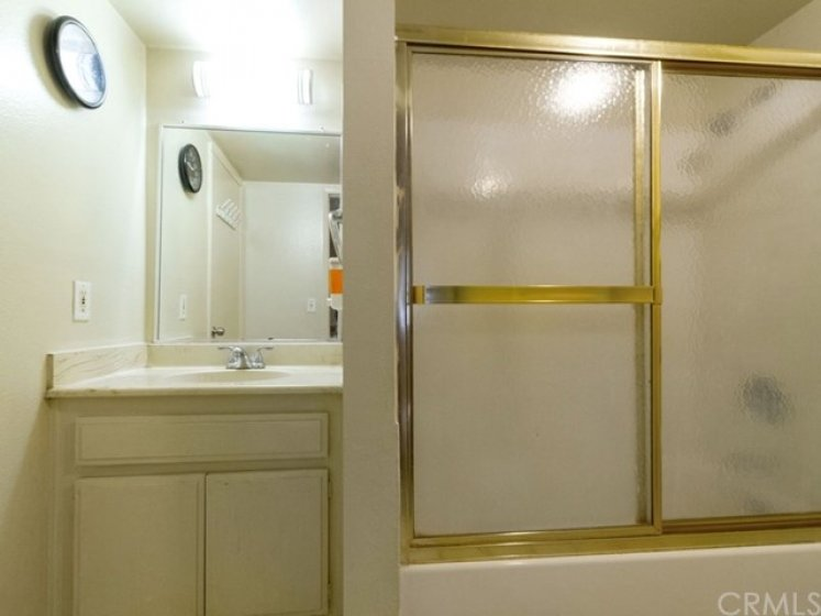 Upstairs bath has two vanities - one on the other side of the wall.