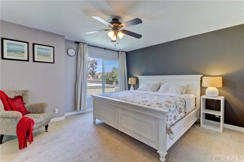 Oversized master bedroom with ceiling fan