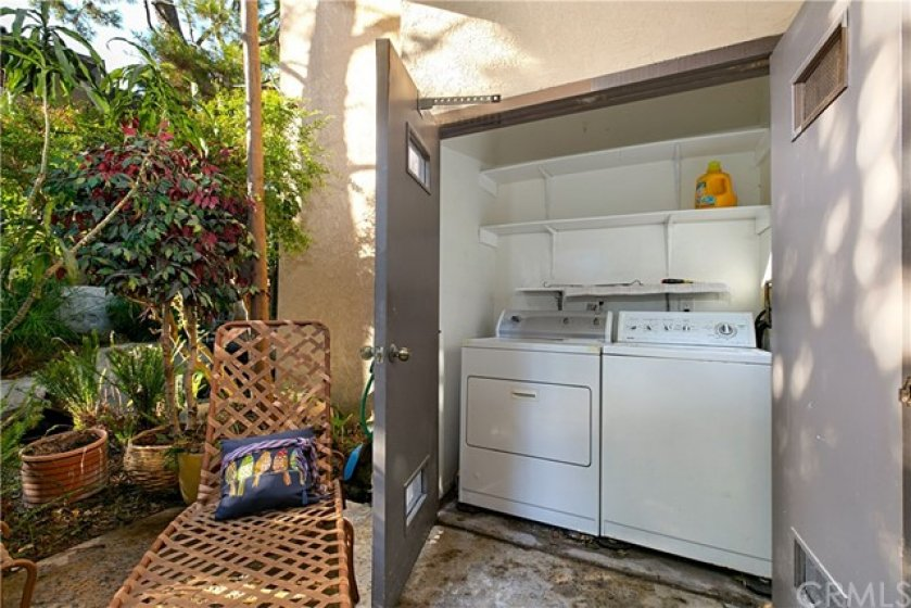 Private laundry closet on rear patio close to master bedroom