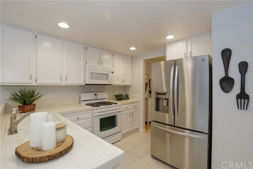 Open Kitchen with lots of cabinets and recessed lighting