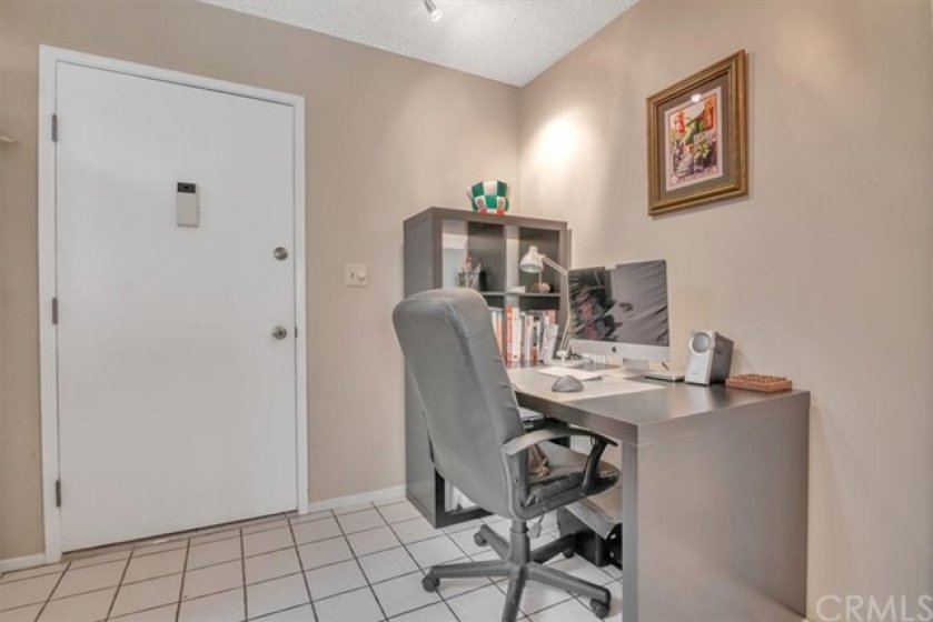 Extra space by entry door for a desk and chair.