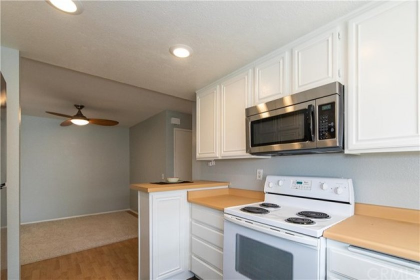 Kitchen with custom painted cabinets