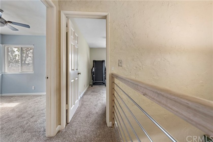 Hallway view of the 2nd and 3rd bedrooms.