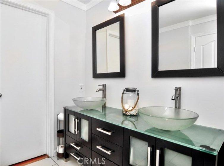 Close-up view of master bathroom vanity with designer vessel sinks