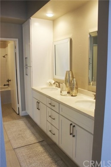 New master bathroom cabinets, sinks, faucets, and lighting.