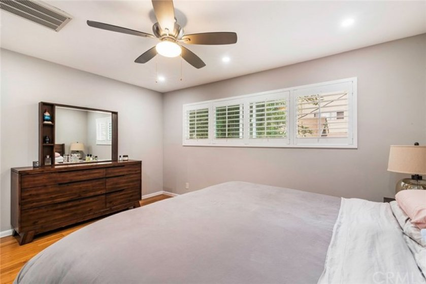There is electric heater in the ceiling, a ceiling fan and newer plantation shutters in the master bedroom.