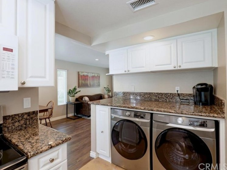 The washer and dryer are full sized and smartly set to maximize space in the home.