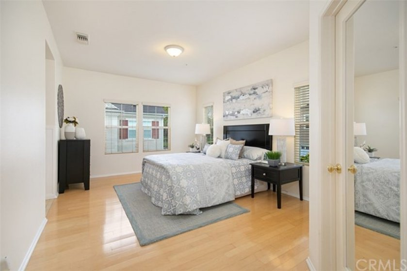 Master bedroom has wood floors, plenty of windows for a light and bright feel and can easily accommodate your CalKing bed.