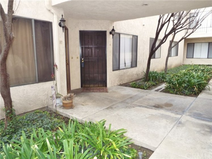 Front of unit just a short walk from the entrance into the community and very close to pool and spa.