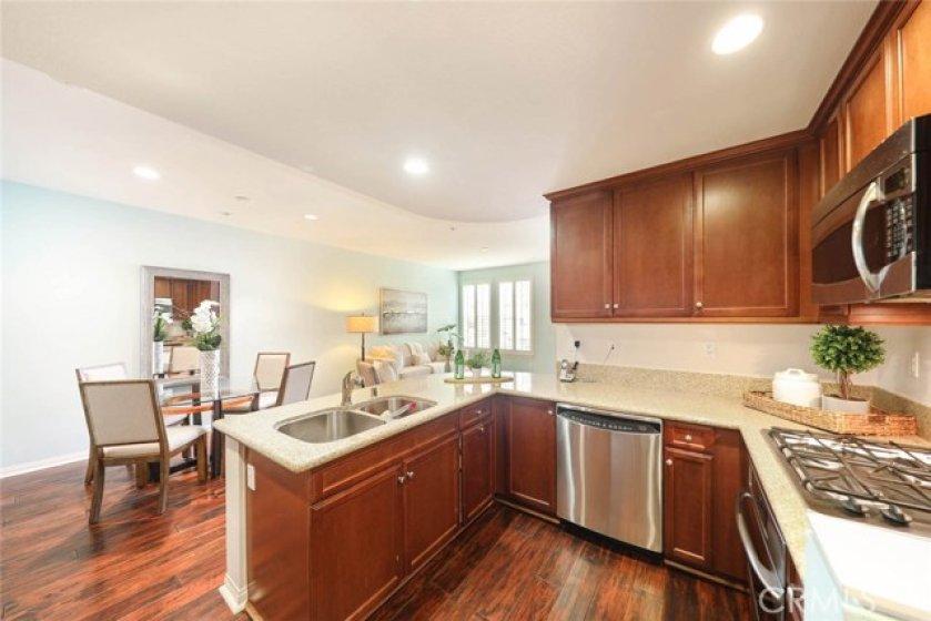 Stylish granite countertops adorn this tastefully designed kitchen.