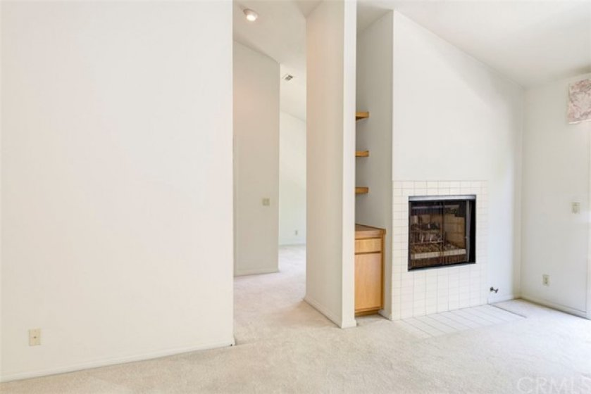 Fireplace, retreat, balcony! This master has it all!