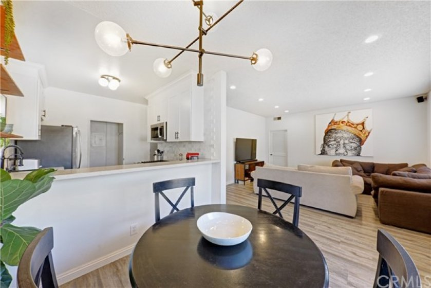 Open view of the kitchen, dining area and living room.