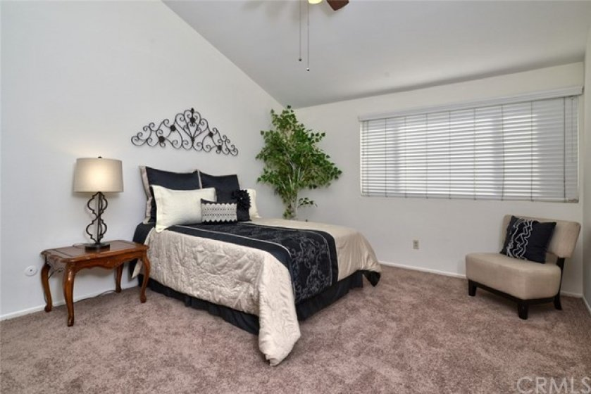 The master suite has ample space for king-sized furniture and also has a cathedral ceiling and cooling ceiling fan.