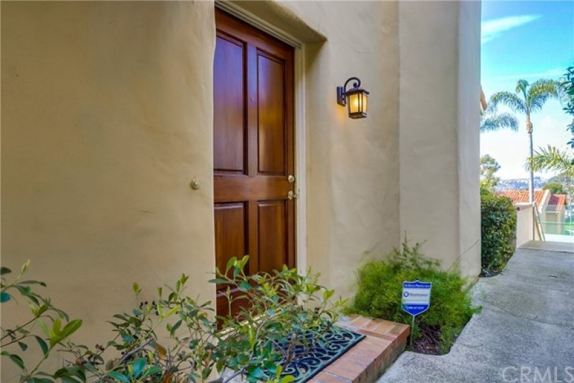Charming town-home style condo in the highly desirable gated community of Cancun Racquet Club!