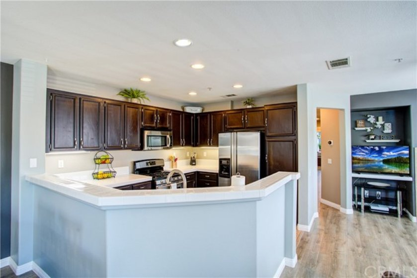Kitchen opens to living room and dining areas