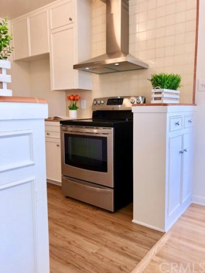 The kitchen is staged with an electric range, but the condo is plumbed for natural gas as well.