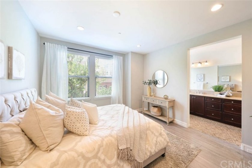 This lovely master suite gives you a calming feeling after a hard days work.