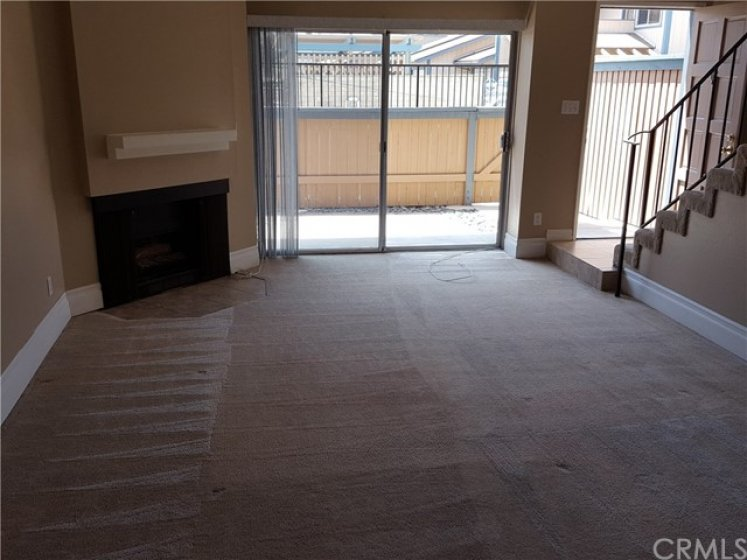Living room with gas fireplace and patio