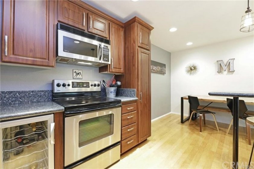 An abundance of cabinet space in this perfect kitchen. Electric stove/oven, microwave, and built wine cooler.