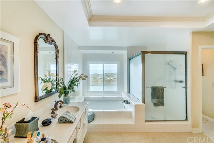 Large Master bath with separate soak tub with views