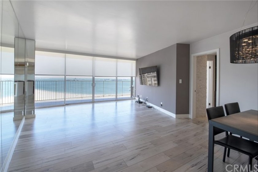 Coastline view from the living room and kitchen.  Privacy blinds on the floor to ceiling windows and sliders.
