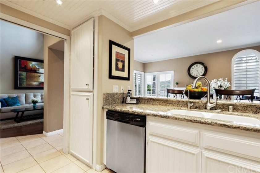 Ample storage in the kitchen includes this pantry. You can see how open and bright this space is!