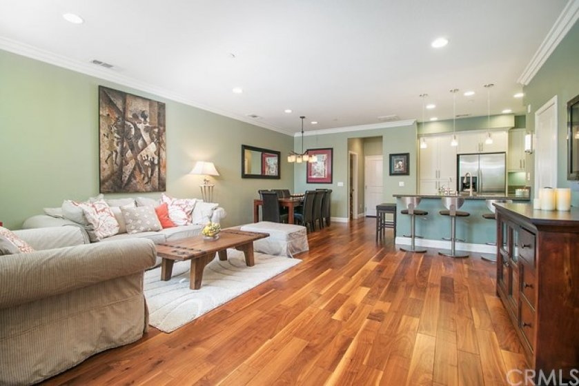 Soothing paint colors and stunning walnut floors beckon you inside.