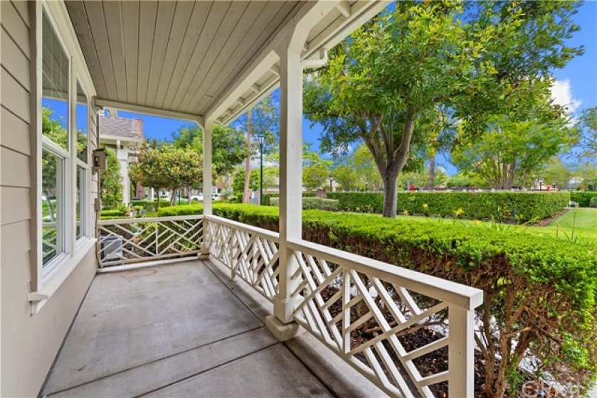 Private porch with mature landscaping surrounding. Open views to the green belt, park and pool. Perfect place to enjoy the California lifestyle.