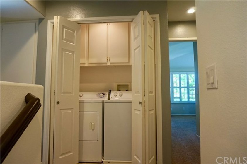 Hello laundry!  Washer/dryer stays, and there is plenty of room overhead for your detergents.  Close up the folding doors when you're done and it tucks nicely away.