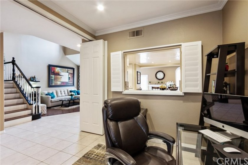 The wide door entry for this area could be flexible space for study or play and is convenient to the kitchen for  entertaining