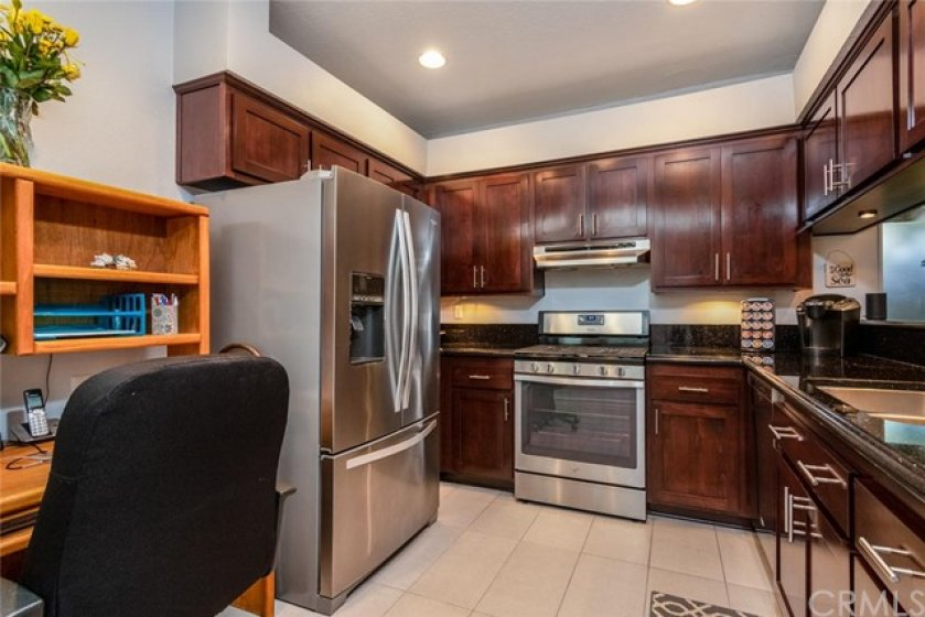 Updated kitchen with raised panel doors and drawers, stainless appliances too.