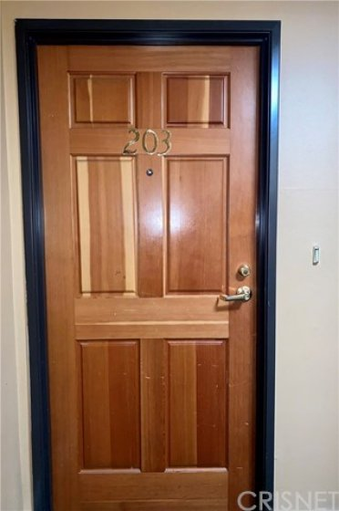 Front Door to Unit. Updated Locks. Traditional Doorbell.
