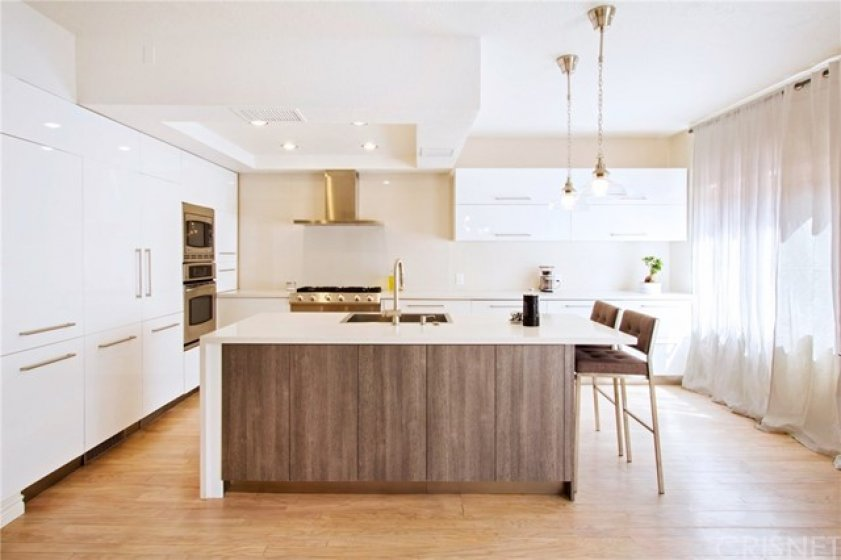 Recently remodeled modern kitchen with built in appliances. Chefs would love to cook and entertainer here!  6 burner professional series Electrolux cooktop!