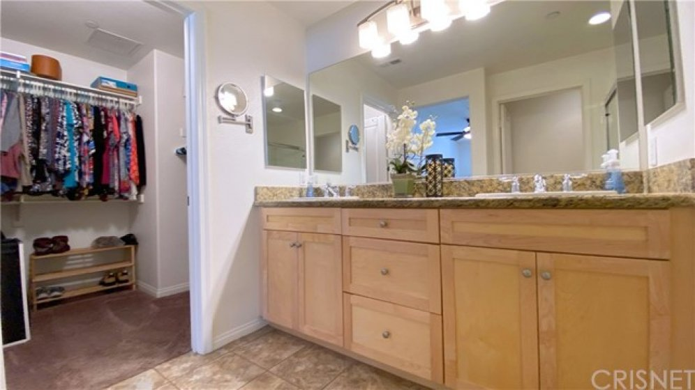 View of Master Bathroom and large walk-in closet.