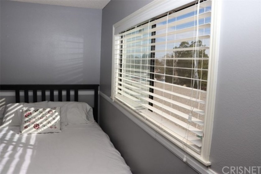 Encased dual paned windows with horizontal blinds.