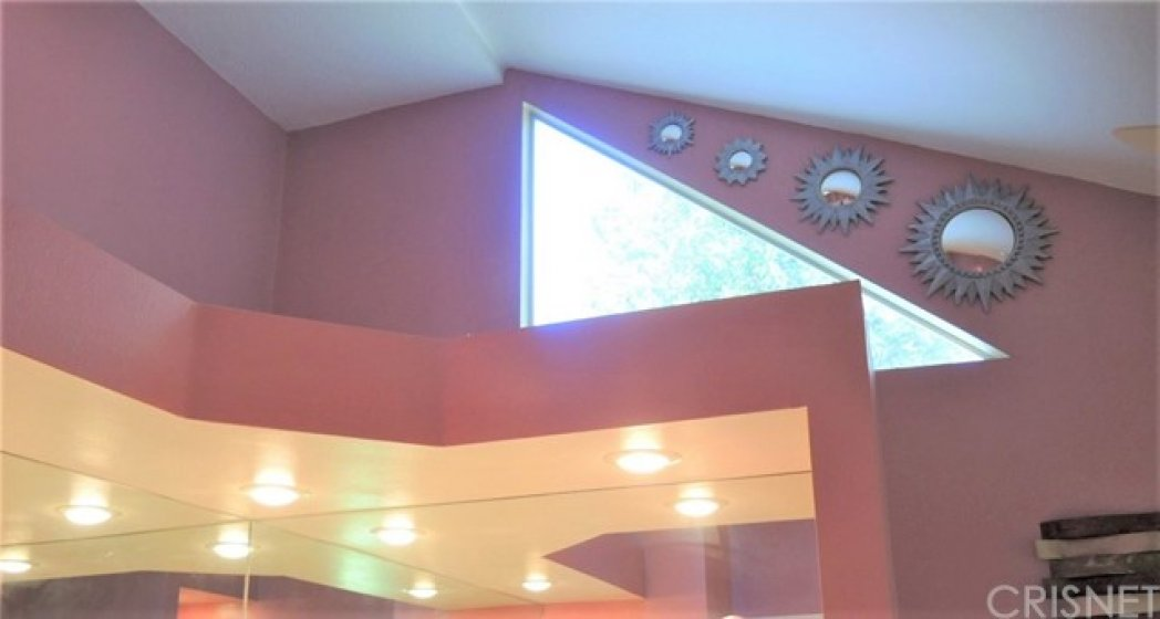 Closer view of the high ceiling and architectural details that add interest and light