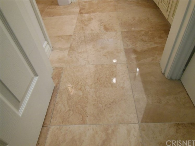 Polished travertine stone throughout