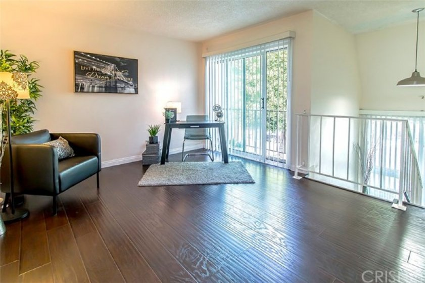 Second bedroom/Office space with sliding glass doors overlooking front of condo