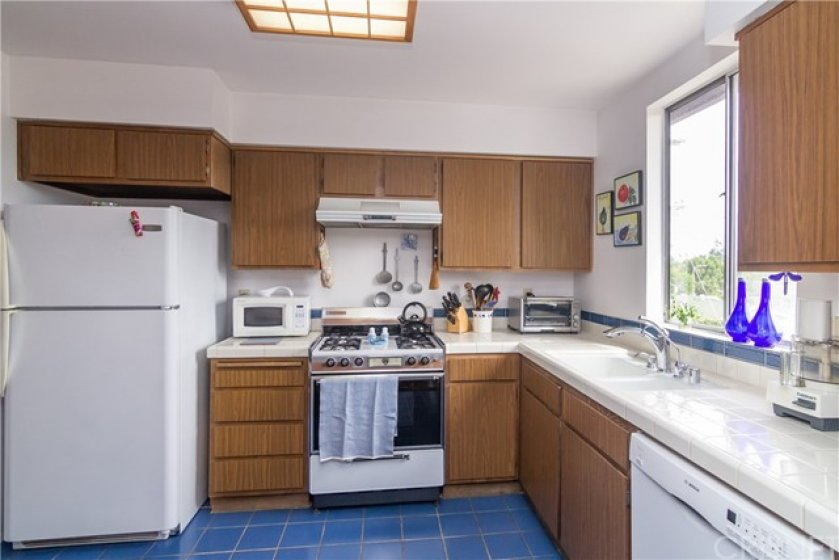 Cheerful kitchen includes the refrigerator & microwave.