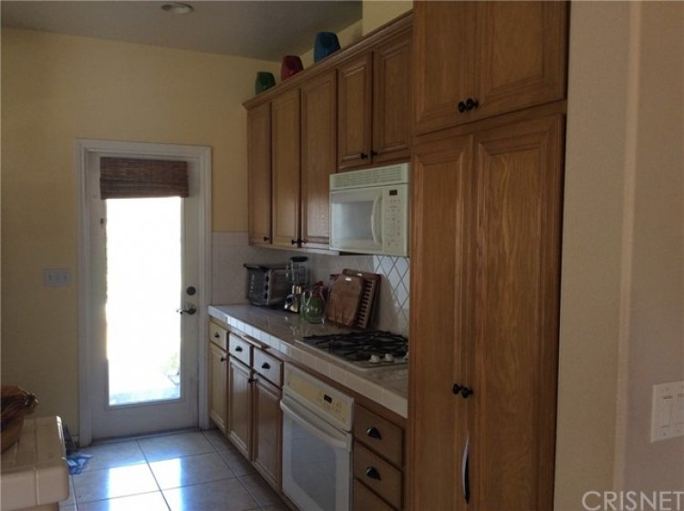 Kitchen has door to outside yard