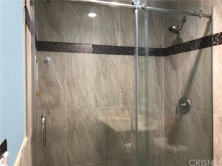 Fully tiled shower with built-in bench