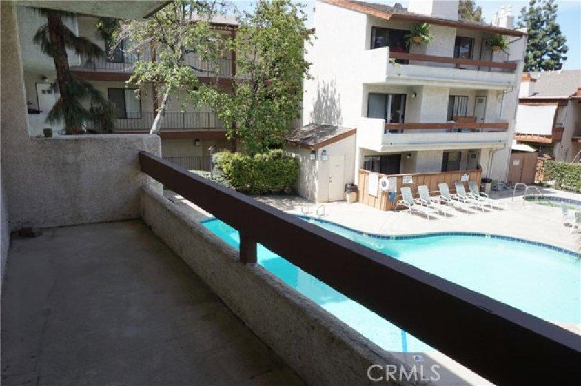 Spacious balcony in quiet complex overlooking pool